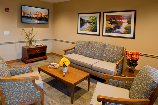 Long-term residents are also benefiting from renovations to spaces throughout each facility, such as this family lounge.