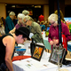 Shoppers peruse the silent auction