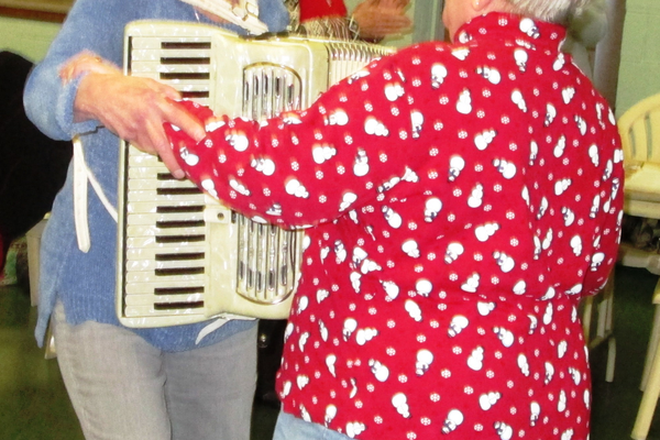 Judy Wadsworth dances a polka with a member of the audience.