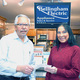 Bellingham Electric president Bob Allaire presents a gift certificate to Pauline Hamwey