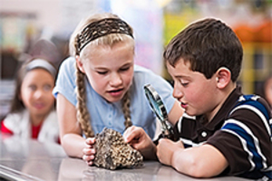 Medium kids examine rocks