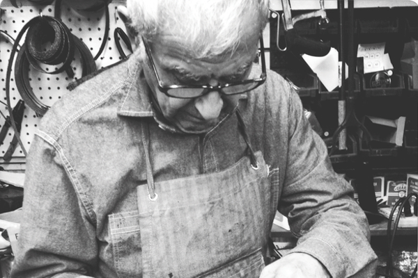 George Sheklian, who passed away last December, is pictured repairing a customer's shoe. He operated Sierra Shoe Repair at various Fresno locations since 1963.
