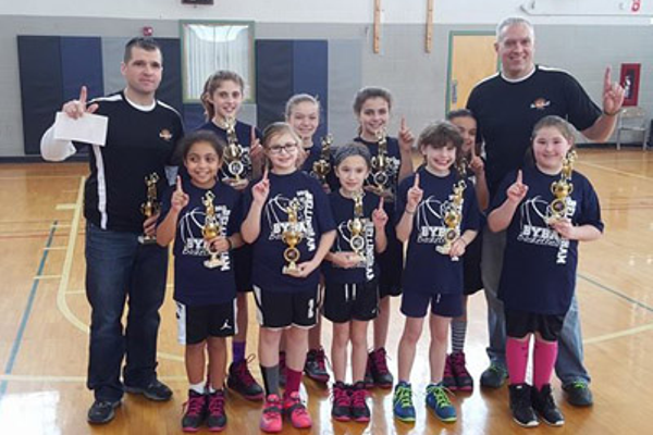 3rd-4th-5th grade Girls Champions—Bellingham Police Back (L-R): Riley Pepin, Kylie Walden, Sabrina Paturzo, Amanda Rotigloano, Coach Brian Pepin; front (L-R): Coach Jon Walden, Angelina Wilson, Kiera Daly, Lucy Walden, Isabella Anderson, Kaitlyn Riolo