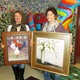 Featured artist Helena van Emmerik-Finn left and donating artist Mary Styer Holton in the lobby of Chadds Ford Elementary School