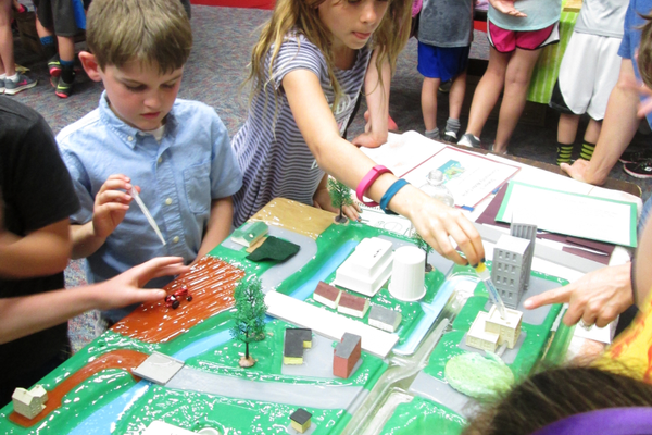 Students move water around a simulated cityscape.