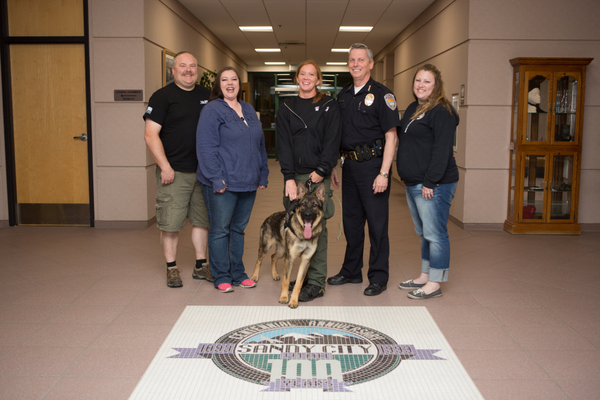 From left to right: Havoc K9 trainer Dustin Draper, Havoc K9 Executive Director Ricki Draper, Sandy City Officer Kaley Erickson with K-9 Bronx, Sandy City Police Chief Keith Thacker, Havoc K9 puppy raiser Sara McKenzie. (Sarah Knight Photography via Sandy City Police)