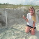 2016: Egg for Research from Year's 1st Nest: Georgia Conservancy's Laura Buckmaster on Cumberland Island at 2016's first loggerhead nest, with the single egg collected from each Georgia nest for genetics research. Sea turtle nests are documented and monitored by the Georgia Sea Turtle Cooperative, a DNR-coordinated network of volunteers, researchers and agency employees who work with the protected turtles and their nests under a federal permit. Here, the nest is covered with a screen to shield the eggs from coyotes, raccoons and other predators. Credit: Doug Hoffman/National Park Service