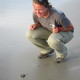 Hatchling on Blackbeard Island (2012): On Blackbeard Island, Sea Turtle Cooperative member Molly Martin of the U.S. Fish and Wildlife Service sees her first hatchling. Mark Dodd/Ga. DNR