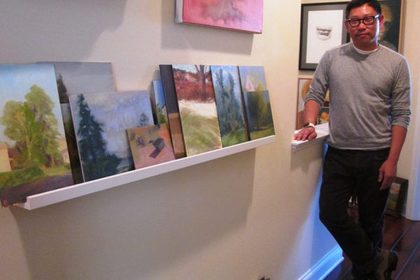 Chow lives with his paintings throughout his Kennett Square home.