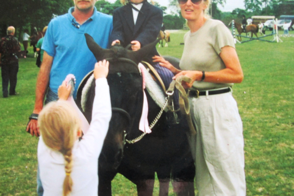 Young Juliana Hutchings on a horse, with her parents and sister.