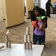 Natalie Harris helps her daughter, Keda Harris, shoot down a pyramid of toilet paper dowels with a Nerf gun at the South Jordan Youth Council's Star Wars carnival.  – Tori La Rue