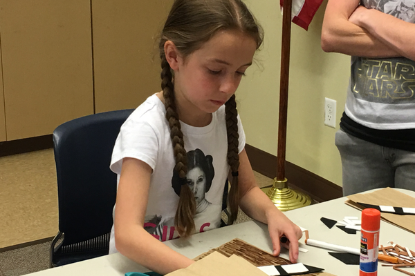 "Nine-year-old Raya Tanner makes a Chewbacca puppet at the South Jordan Youth Council's ""May the Fourth Be With You"" event. – Tori La Rue"