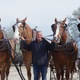 Darin Palmer, a longtime South Jordan resident, stands with his team of four Belgian draft horses. –Linnea Lundgren