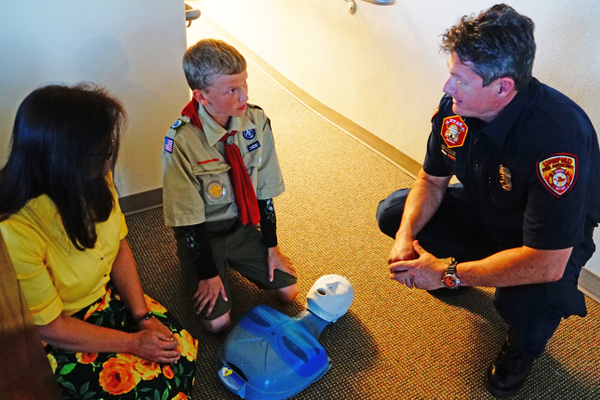 "A local scout learns ""Push to Survive"" during Riverton's council meeting. Photo courtesy of ©Riverton City Communications."