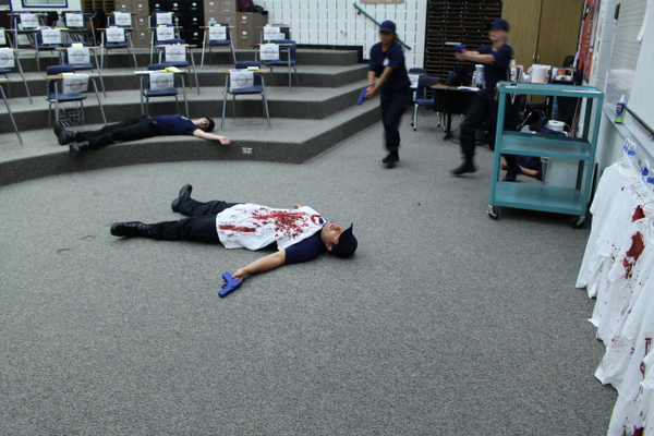 Explorers pose a murder-suicide scene after an active shooter situation for explorers to train clearing a room during a shooter incident at Eastmont Middle School on June 14, 2016. (Photo: Chris Larson, Sandy City Journal)