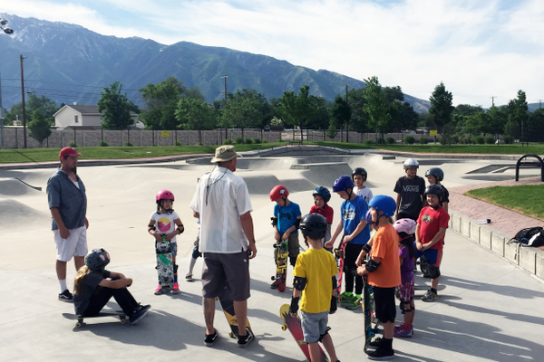 Camp founder and skateboarding coach Eric Uquillas, aka Spock, talks with a group of skaters before beginning the first summer session at the Sandy Skate Park. Uquillas is passionate about establishing respect and safety as the foundation of skateboarding. —Sarah Almond