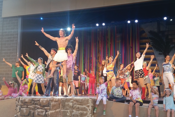 "Joseph, played by Trent English, is held aloft at the end of the song ""Go, Go, Go Joseph."" —Kelly Cannon"