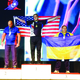 Draper's Robert Baxter stands with the American flag as the national anthem plays for his title as world arm wrestling champion. —Julie Baxter