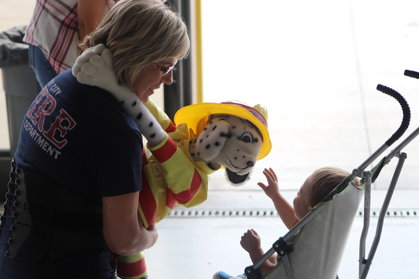 Fire prevention specialist Lenore Corey and her partner Sparky at the press event announcing the release of ParentsEmpowered videos featuring Sandy firefighters and the display of anti-underaged drinking graphics on various Sandy firefighting vehicles at Sandy City Fire Station 31 on June 30, 2016. (Photo: Chris Larson, Sandy City Journal)
