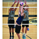Tristan Penrod and Trevor Sampson attempt to block a shot during the boys state volleyball tournament. –UBVA