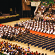 In the arena, students wait for graduation processions to begin. —Island Photography