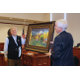 Former Holladay Mayor Webb presents painting. —Carol Hendrycks