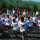 Summit Academy kindergartners and first-graders took off at the start of the school's May 26 fun run, Jogapooloza. Also included before the event was a dinner, art gallery stroll and silent auction. It concluded with prize raffles and dunking the principal and assistant principal. — Julie Slama
