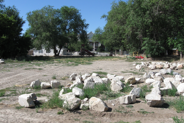 The property, currently a vacant lot with multiple large rocks, would have seen a daycare facility expand into the area with additional parking. —Travis Barton