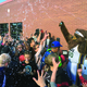 The Utah Jazz Bear surprises Altara Elementary students with silly string before the presentation of a $500 check to the school as the winners of the Utah Department of Transportation's Spring Walk 'n Win contest. — Julie Slama