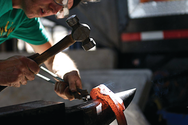 A contestant works on a horseshoe at a World Championship Blacksmith competition in Herriman. –Joe Oliver
