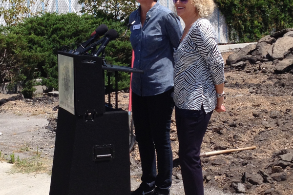 City Councilwoman Lisa Adams stands to the left of Mayor Jackie Biskupski answering questions during a news conference at the ceremonial demolition of the Ute Car Wash. –Travis Barton