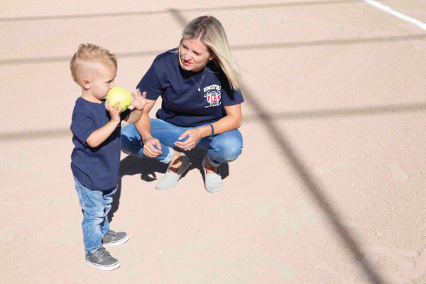Austin Ault, 6, gears up to throw the ceremonial first pitch in honor of his recently passed-away best friend and little brother, Tanner, at Unified Fire Authority and the Unified Police Department's Guns vs. Hoses softball tournament. --Unified Fire Authority