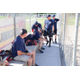 Firefighters sit in the dugout during their annual softball match against the Unified Police Department. This year the Unified Fire Department invited a family, with whom they've worked closely, to join them at the game as honorary teammates. --Unified Fire Authority