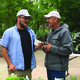 Jason Hill talks to Barney Barnett, of Willard Bay Gardens, about the specifics of the type of plant he is holding during the second annual Plant Con at Conservation Garden Park. One of the main purposes of the convention was to educate participants about water-wise specimens. – Tori La Rue