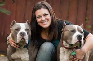 Fresno Bully Rescue Shelter Director Bridgette Boothe with two of her pups