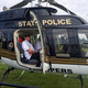 A police helicopter landed in the park and stayed open for visitors