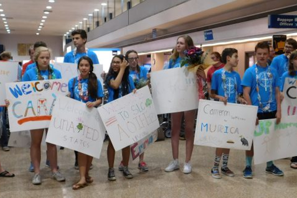 Americans teens hold up posters to welcome teens from Northern Ireland into Utah for the Utah Ulster Project. The Ulster Project is a peace project designed to bring Protestant and Catholic teens together despite their differences.  – Utah Ulster Project