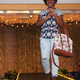 Saabiraa R. models clothes from JcPenney during the annual Back-to-School Fashion Preview Aug. 17, 2016 at the Maple Grove Community Center. (Photo by Wendy Erlien)