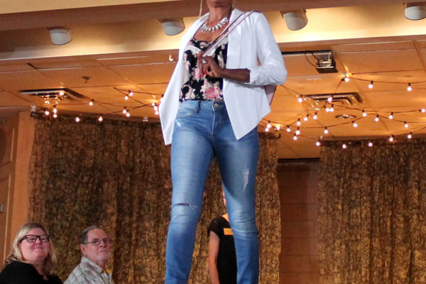 Lou B. models clothes from Apricot Lane during the annual Maple Grove Fashion Flair August 18, 2016 at the Maple Grove Community Center. (Photo by Doug Erlien)