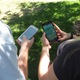 Ben Segee and Amy Wyman catch Pokémon with their phones as they play the ultra-popular augmented reality game, Pokémon Go. –Travis Barton