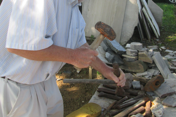 Bailey shows some of his chisels outside his workshop.