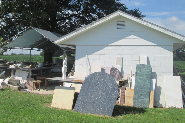 Bailey's workshop is surrounded by slabs of granite and marble awaiting their turn to be made into art or tabletops.