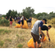 Students pull weeds during the Helping Hands Day service project. Promise South Salt Lake and Westminster partner together bringing students to both service projects and to tutor the city's youth. –Travis Barton