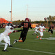 Maple Grove's Brad Davison (10) searches for a receiver against Osseo. (Photo By: Doug Erlien)
