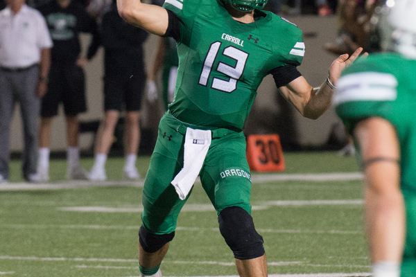 Quarterback Mason Holmes throws for one of his 3TD passes as the Dragons defeated rival Euless Trinity by a score of 42-28 at Dragon Stadium on September 30, 2016. Photo by SnappedDragons.com/S. Johnson.