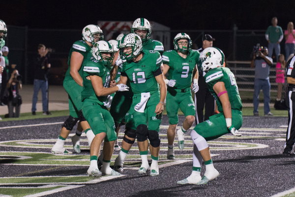 The Dragons celebrate in the end zone after a Holmes to Johansson TD pass.  The Dragons defeated rival Euless Trinity by a score of 42-28 at Dragon Stadium on September 30, 2016. Photo by SnappedDragons.com/S. Johnson.
