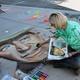 Tonya Youngberg works on a John Wayne portrait for her dad. –Sandra Osborn