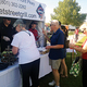 Residents stand in line at the Brick Oven Booth to get food. (Mylinda LeGrande/City Journals)