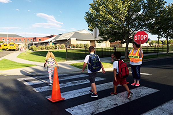 "Daybreak Elementary crossing guard Vickie Hicks has been giving students a smile and a friendly ""good morning"" for the past 10 years, as long as the school has been open. (Julie Slama/My City Journals)"