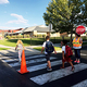 """Daybreak Elementary crossing guard Vickie Hicks has been giving students a smile and a friendly """"good morning"""" for the past 10 years, as long as the school has been open. (Julie Slama/My City Journals)"""